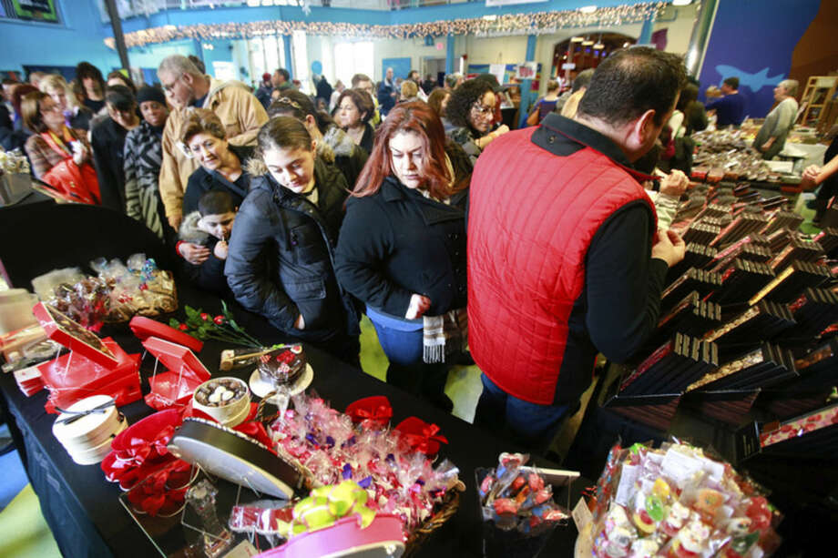 Hour photo/Chris PalermoVisitors admire the chocolate on display at the annual Chocolate Expo at the Maritime Aquarium in Norwalk Sunday.