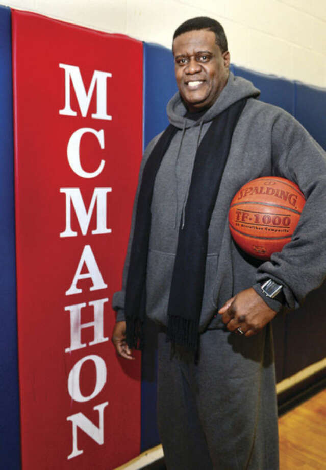 Hour photo / Erik Trautmann Brien McMahon High School security guard, Paul Atkins, is a former McMahon basketball player.