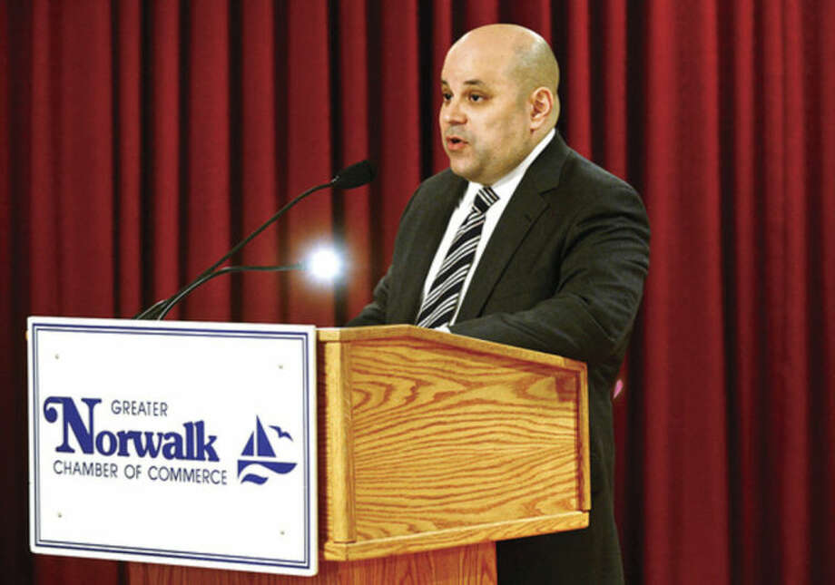 Hour photo / Erik Trautmann Felix R. Serrano, chairman of the Norwalk Redevelopment Agency Commission, speaks during the Greater Norwalk Chamber of Commerce's annual Economic Outlook Luncheon at Continental Manor Thursday.