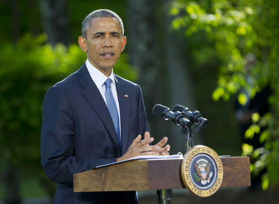 FILE - In a Thursday, May 14, 2015 file photo, President Barack Obama speaks during a news conference after meeting with Gulf Cooperation Council leaders and delegations at Camp David in Maryland. In a surprise announcement on Monday, May 18, 2015, coming nine months after police in riot gear dispelled racially charged protests, President Obama is banning the federal government from providing some military-style equipment to local departments and putting stricter controls on other weapons and gear distributed to law enforcement. (AP Photo/Pablo Martinez Monsivais, File)