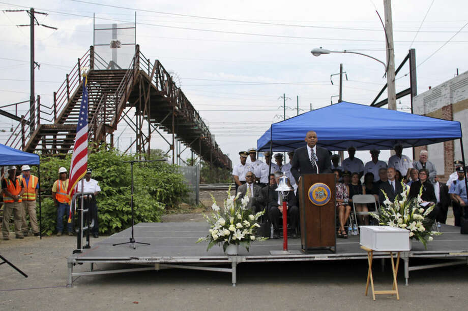"Anthony Foxx, U.S. Secretary of Transportation, speaks during a service of reflection near the site of an Amtrak train derailment Sunday May 17, 2015, in Philadelphia. The U.S. passenger train operator Amtrak will resume full service in the Northeast Corridor on Monday in ""complete compliance"" with federal safety orders following last week's deadly derailment, officials announced Sunday. (AP Photo/ Joseph Kaczmarek)"