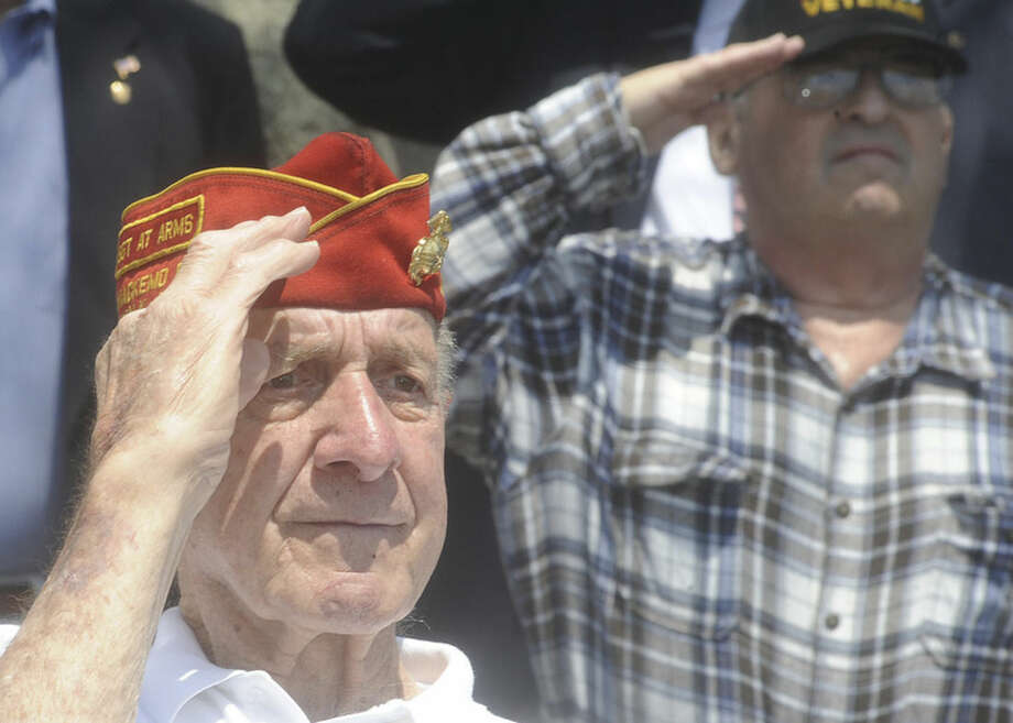 Hour photo/Matthew VinciWorld War II Marine veteran Joe Lametta salutes at the annual Shea-Magrath Memorial Ceremony Sunday.