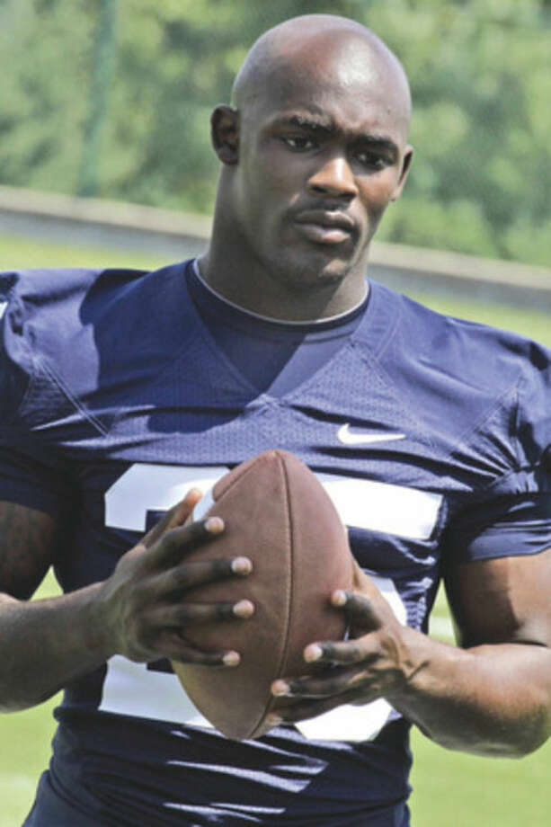 In this file photo taken Aug, 16, 2011, Penn State tailback Silas Redd takes part in the college football team's media day in State College, Pa., Tuesday, Aug. 16, 2011. Redd will be stepping in for the career school rushing leader Evan Royster this season as a sophomore. (AP Photo/Gene J. Puskar, File)
