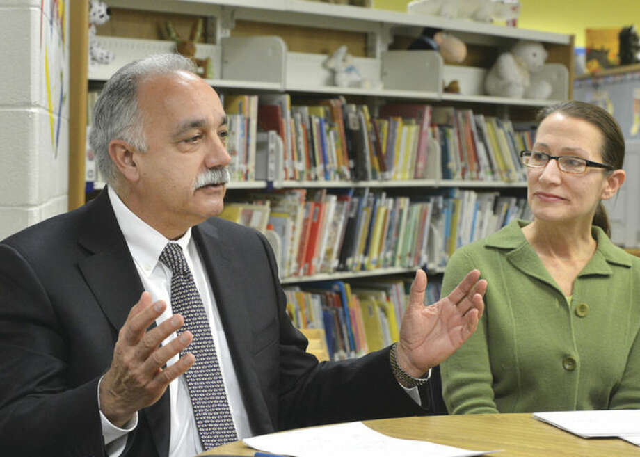 Hour Photo/Alex von Kleydorff Board Members Dr. Manuel Rivera and Diane Lauricella talk about the Mayors new Energy and Environment Task Force during a press conference at Naramake School on Thursday