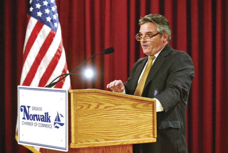 Hour photo / Erik Trautmann Timothy T. Sheehan, Executive Director of the Norwalk Redevelopment Agency, speaks during the Greater Norwalk Chamber of Commerce's annual Economic Outlook Luncheon at Continental Manor Thursday.