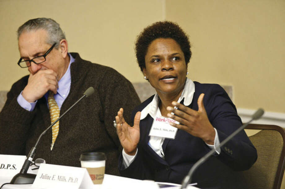 Hour photo / Erik Trautmann Dr. Juline Mills, Chair the College of Business, Department of Hospitality and Tourism, The University of New Haven, during the second of Workplace Inc.'s Workforce Forum Series, Retail and Hospitality, at the Hilton Garden Inn Thursday morning.