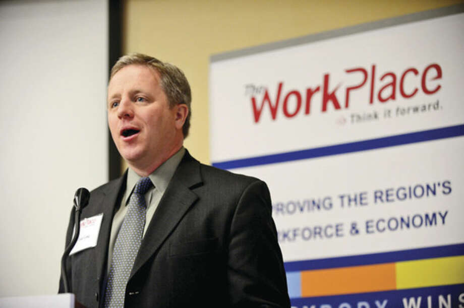 Hour photo / Erik Trautmann Tom Long, VP, Marketing & Communications for Workplace Inc., welcomes employers and job seekers, during the second of Workforce Forum Series, Retail and Hospitality, at the Hilton Garden Inn Thursday morning.