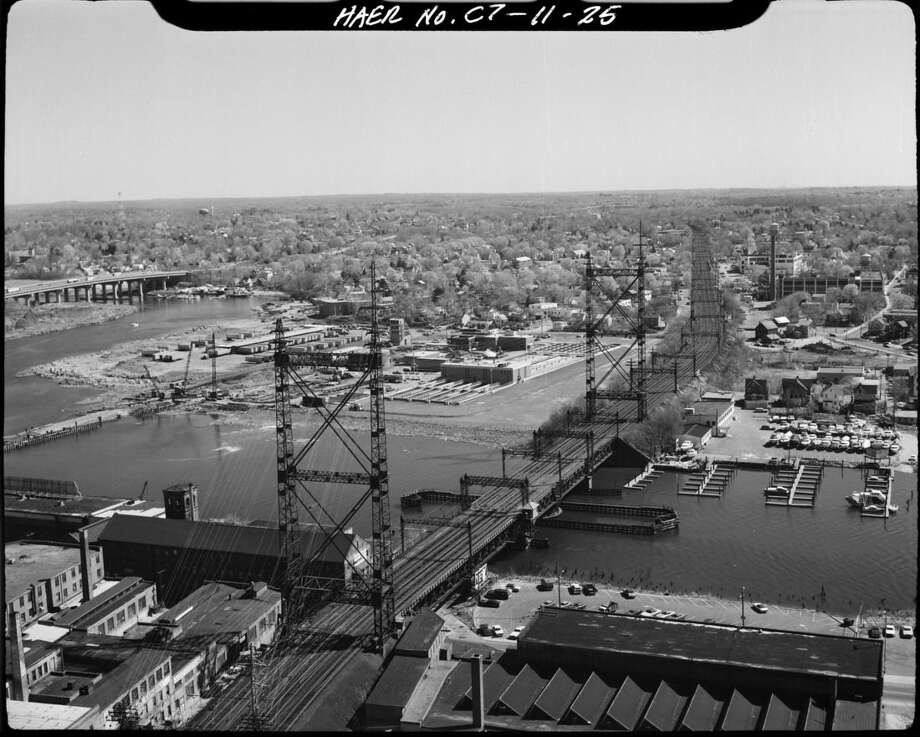 """This circa 1968 photo made available by the Library of Congress shows the Norwalk River Railroad Bridge in Norwalk, Conn., along the Northeast Corridor. Officials are working on a plan to replace the swinging bridge which was built in 1896. """"As a piece of engineering, it's just amazing,"""" said John Bernick, assistant rail administrator for the Connecticut Department of Transportation. """"But, it's certainly reached its retirement age."""" (Library of Congress via AP)"""