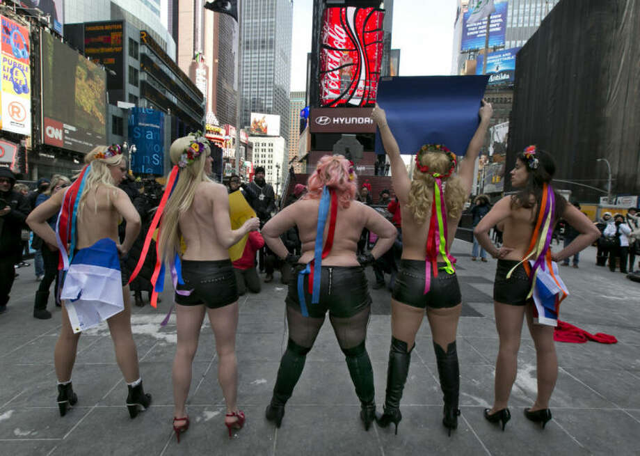 EDS NOTE: NUDITY - Female activist members of FEMEN go topless during their anti-Putin, pro-Ukraine demonstration in New York's Times Square, Thursday, March 6, 2014. (AP Photo/Richard Drew)