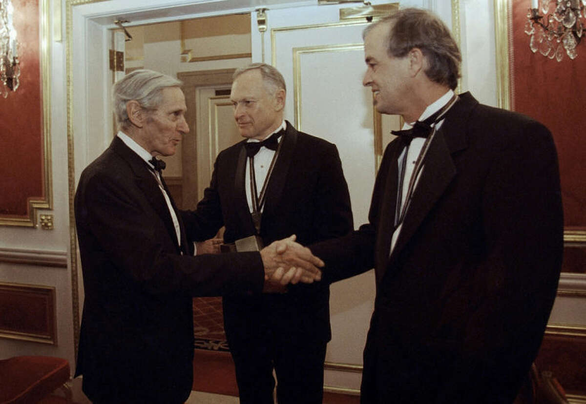 FILE - In this Nov. 16, 1994, file photo, The National Book Awards prize winning writers, William Gaddis, left, Sherwin B. Nuland, center, and James Tate greet each other after the awards ceremony in New York. Nuland, the author of 1994 National Book Award winner