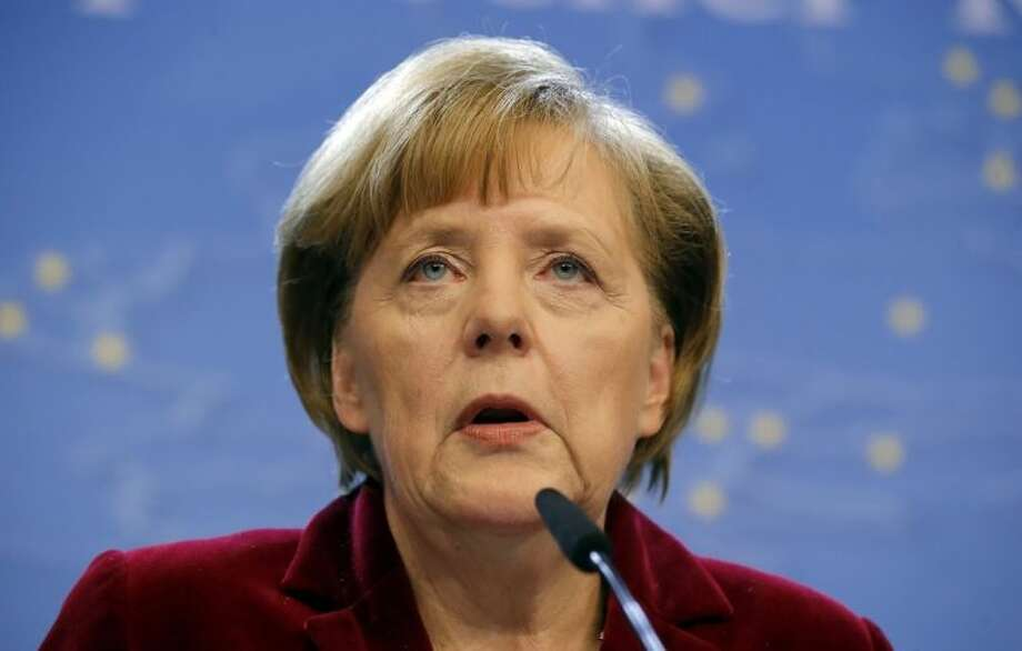 German Chancellor Angela Merkel speaks during a media conference after an EU summit in Brussels on Thursday, March 6, 2014. European Union leaders are holding an emergency summit to decide on imposing sanctions against Russia over its military incursion in Ukraine's Crimean peninsula. (AP Photo/Michel Euler)