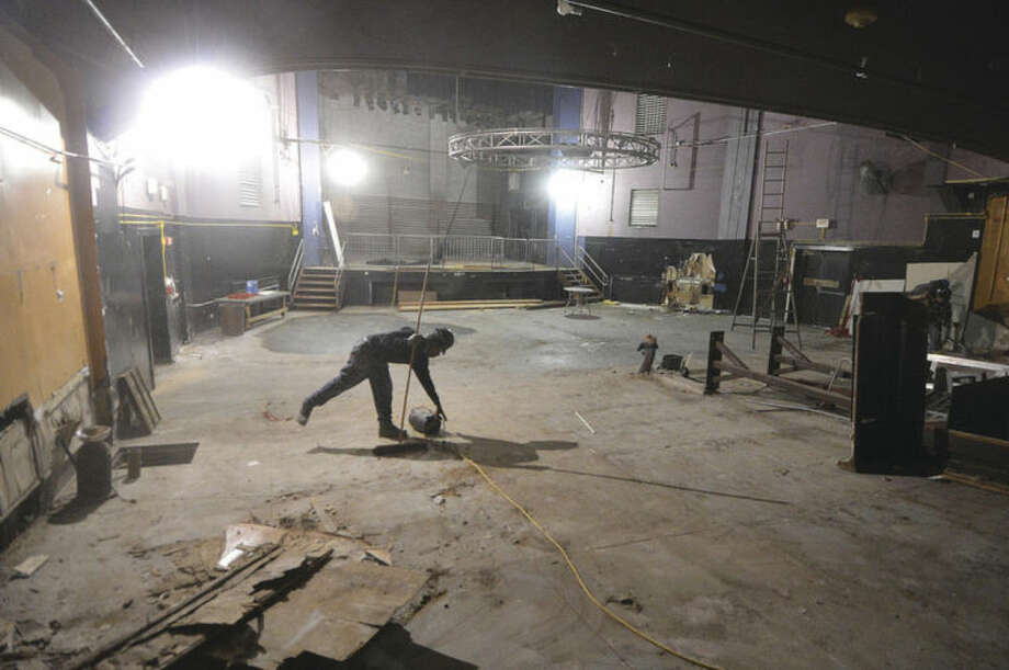 Hour Photo/Alex von Kleydorff Workers make progress on the interior of the Wall Street Theater