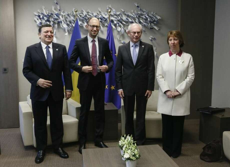 From left, European Commission President Jose Manuel Barroso, Ukraine's Prime Minister Arseniy Yatsenyuk, European Council President Herman Van Rompuy and European Union High Representative Catherine Ashton participate in a meeting during an EU summit in Brussels on Thursday, March 6, 2014. EU heads of state meet Thursday in emergency session to discuss the situation in Ukraine. (AP Photo/Olivier Hoslet, Pool)