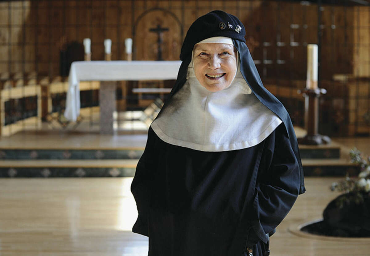 AP photo/Jessica Hill Mother Dolores Hart poses for a photograph at the Abbey of Regina Laudis, in Bethlehem, Conn. Mother Dolores, a former actress who is best known for sharing the first on-screen kiss with Elvis Presley, has helped the Abbey which is in need of renovations gain exposure and aid from fans of Presley.
