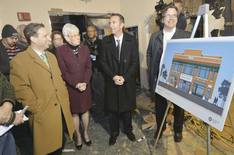 Hour Photo/Alex von Kleydorff Architect Mark Schulman talks about plans for the Wall Street Theater with Frank Ferricker, President of The Wall Street Theater Company as Senator Bob Duff and Lt. Governor Nancy Wyman take a tour of the site on Wall St in Norwalk