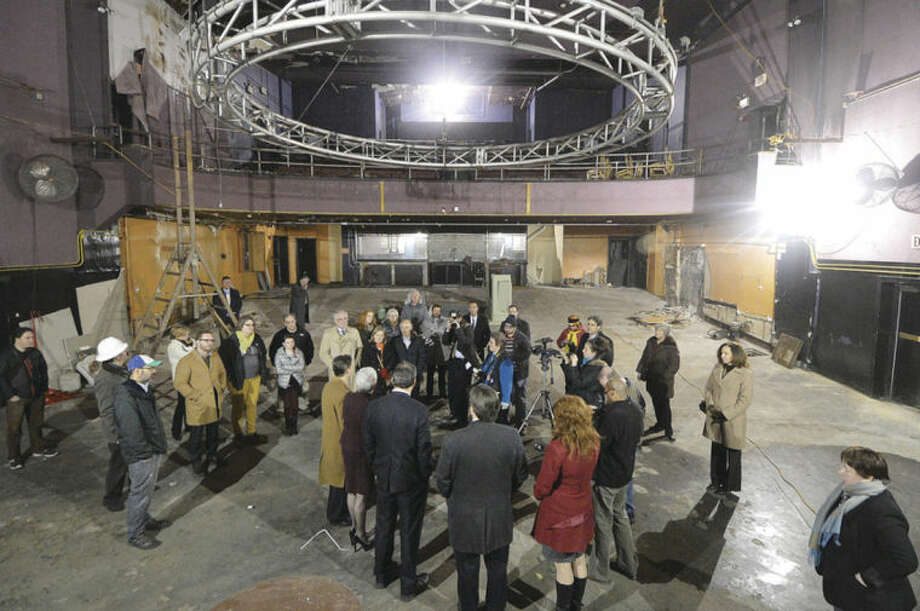 Hour Photo/Alex von Kleydorff. Lt Governor Nancy Wyman with others takes an inside look at the progress being made at The Wall Street Theater on Friday
