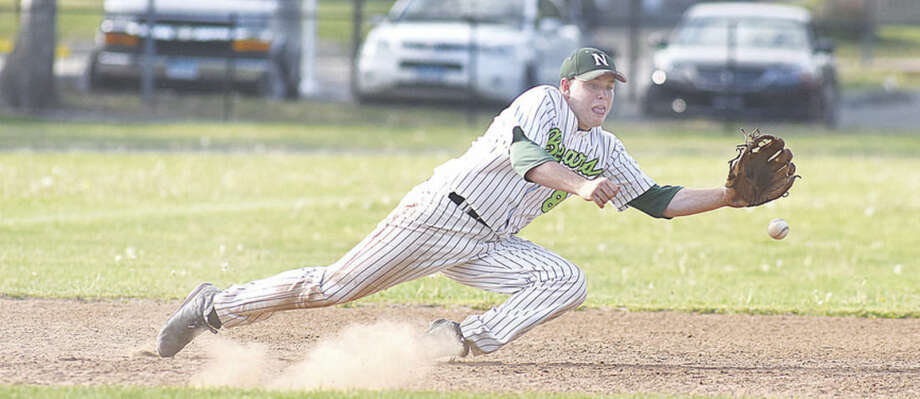 Hour photo/John NashNorwalk's Eddie O'Hara dives in a vain attempt to snare this hard-hit ground ball during Friday's 4-3 extra inning win over Wilton.