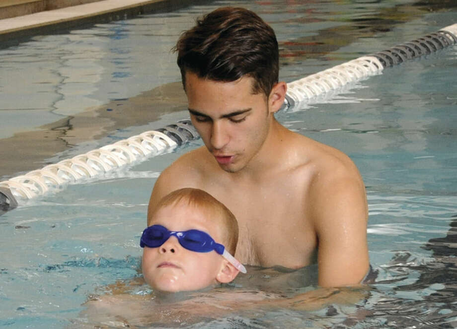 Six year old Noah Welte gets swim safety instructions from Swim Seventy instructor Victor Vega Wednesday. Hour photo/Matthew Vinci