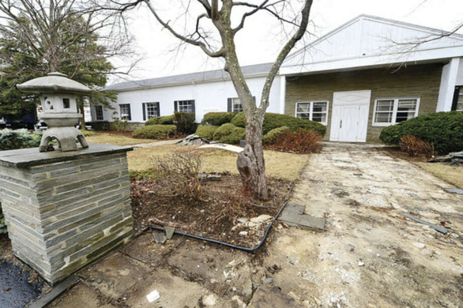 Hour photo / Erik TrautmannA developer has plans to raze the building at 11 Willard Road to create parking lot for an aquatics center.