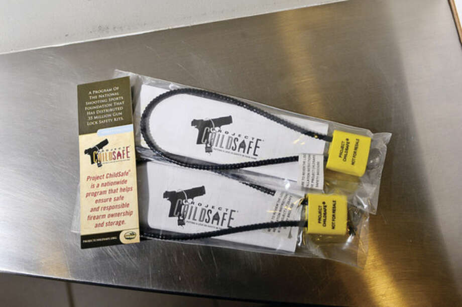 Hour photo / Erik TrautmannThe Norwalk Police Department is offering free gun locks from Project Child safe from the National Shooting Sports Foundation.