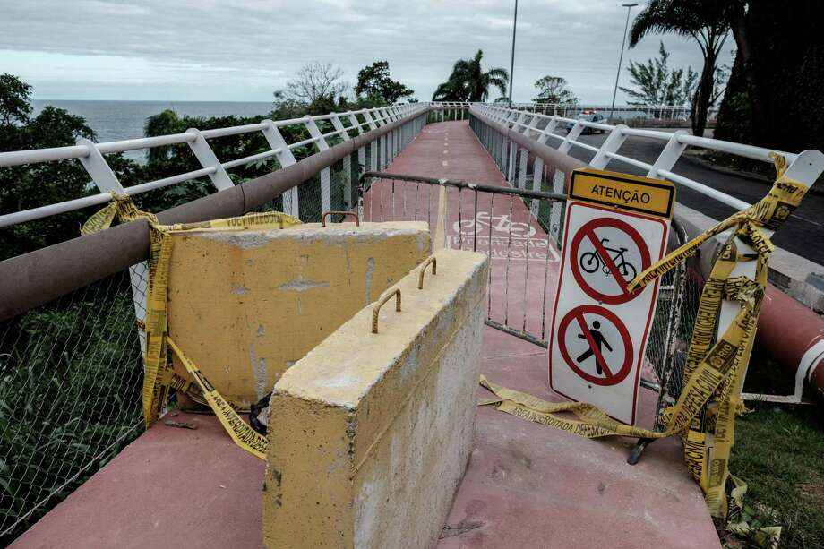 The closed down Ciclovia Tim Maia bike lane, destroyed by a wave leaving two people dead and one missing in Rio de Janeiro, Brazil, on June 13, 2016. About 50 meters of the bike lane was swept away by the wave on Afril 21 after being inaugurated as a major legacy from the 2016 Olympic Games. / AFP PHOTO / YASUYOSHI CHIBAYASUYOSHI CHIBA/AFP/Getty Images Photo: YASUYOSHI CHIBA, Staff / AFP/Getty Images / AFP or licensors