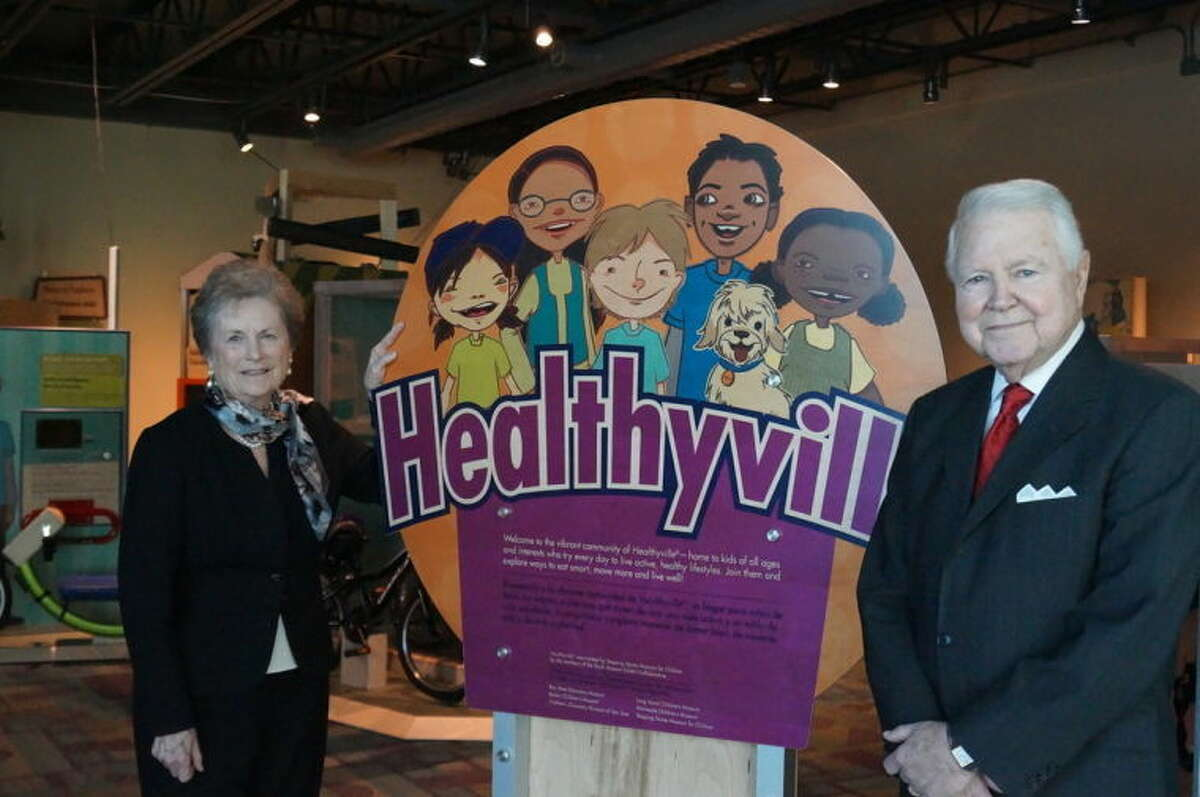 Contributed photo Philanthropists George and Carol Bauer stand by Stepping Stones Museum's Healthyville exhibit.