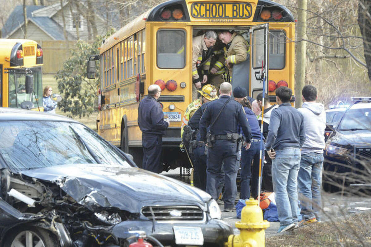 Hour photos / Alex von Kleydorff Several injuries were reported after a West Rocks Middle School bus collided with two motor vehicles on the Wilton-Westport border Thursday. The accident occurred at 3:45 p.m. near Poplar Plains Road in Wilton, off of Route 33. Westport Road was closed to all traffic at 4 p.m. between Westport and Wilton. Wilton, Westport and Norwalk emergency personnel all responded to the incident Thursday. Westport police reported that Wilton Road was closed for approximately one hour from Newtown Turnpike to Poplar Plain Road in Wilton as of 4:30 p.m., Thursday. Parents were being allowed up to the crash site to pick up their children.