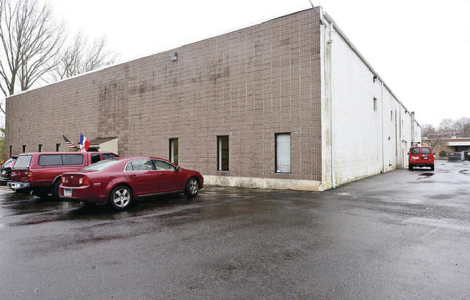 Hour photo / Erik Trautmann A developer has submitted application to build aquatics center at 8 Willard Road off Westport Avenue. The building across street at 11 Willard Road to be razed to create parking lot for pool.