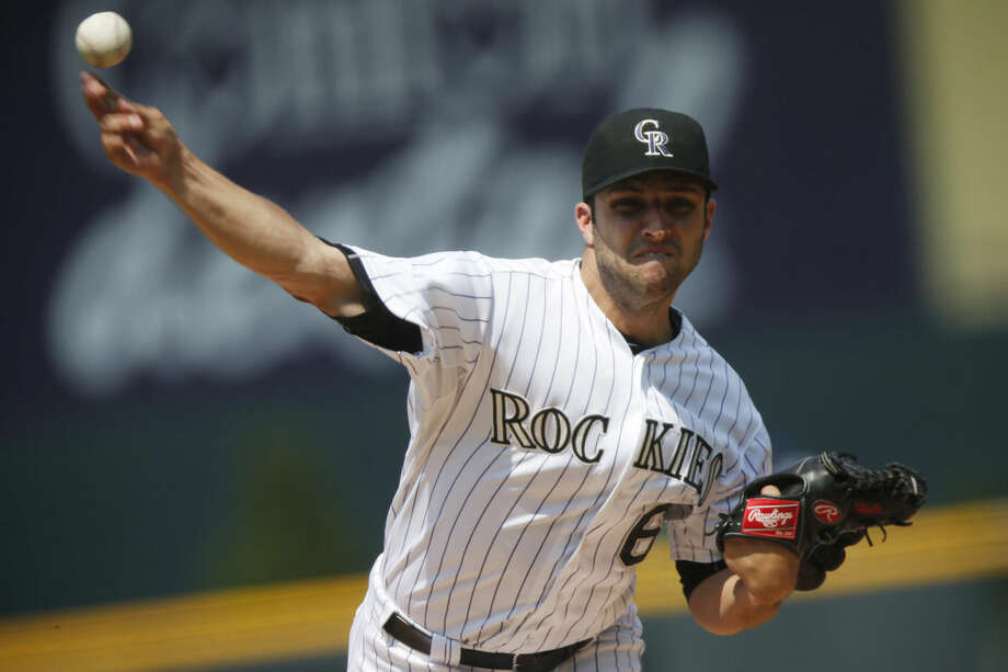 Colorado Rockies starting pitcher David Hale works against the New York Mets during the first inning of a baseball game Sunday, Aug. 23, 2015, in Denver. (AP Photo/David Zalubowski)