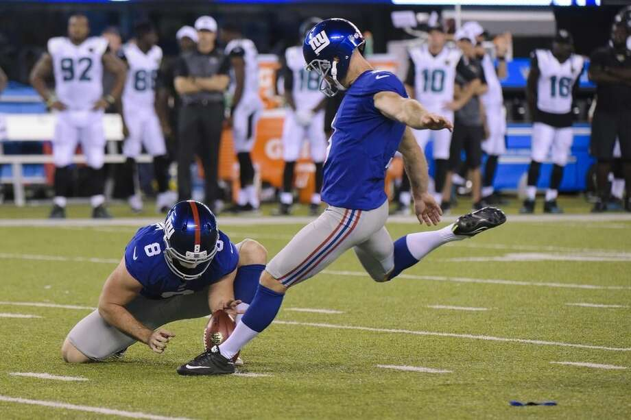 New York Giants kicker Josh Brown, right, boots a field goal during the second half of a preseason NFL football game against the Jacksonville Jaguars, Saturday, Aug. 22, 2015, in East Rutherford, N.J. (AP Photo/Bill Kostroun)