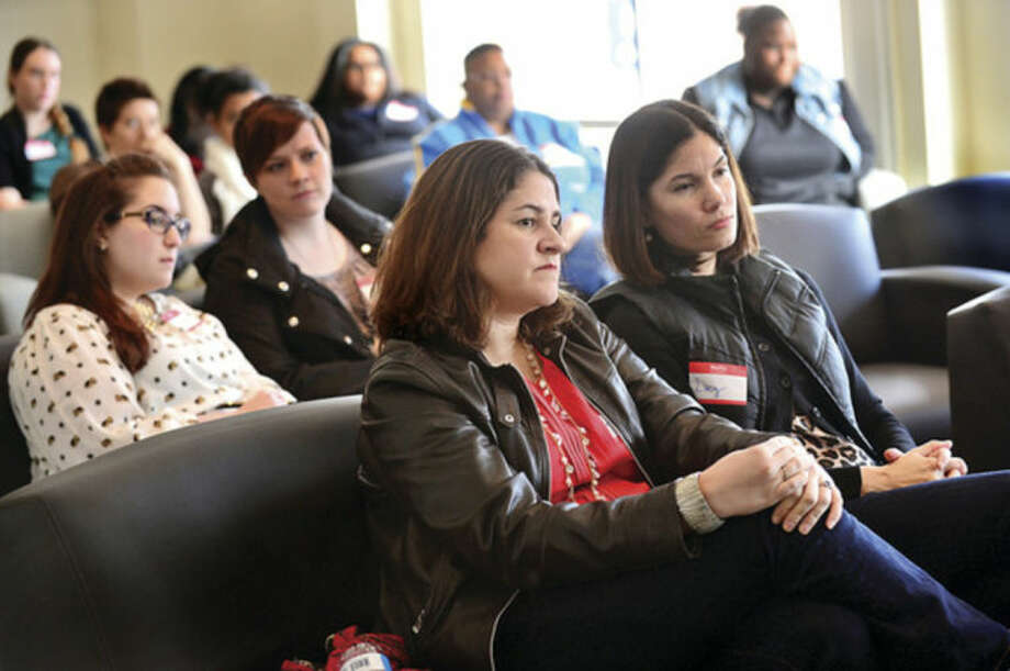 Hour photo / Erik TrautmannCouples listen to a panel discussion with reproductive experts Mark Leondires, psychologistLisa Tuttle, and attorneyLiz Faulker at the Triangle Community Center during the kick off for it's Family Building Series Saturday.