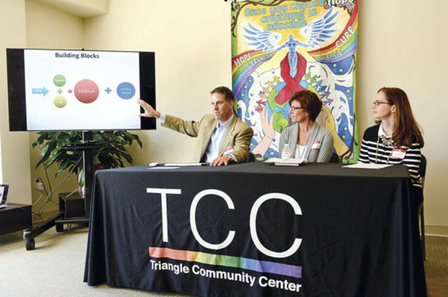 Hour photo / Erik TrautmannMark Leondires speaks at a panel discussion with reproductive experts,   psychologist Dr. Lisa Tuttle and reproductive attorney Elizabeth Swire Falker at the Triangle Community Center during the kickoff for its Family Building Series Saturday.