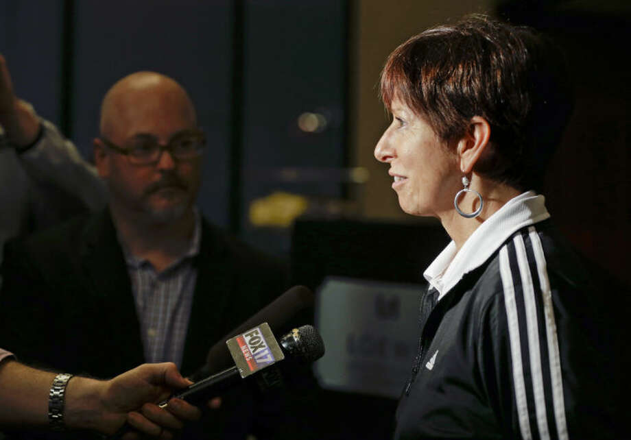 Notre Dame coach Muffet McGraw answers questions after arriving at the team hotel for the NCAA women's Final Four college basketball tournament, Thursday, April 3, 2014, in Nashville, Tenn. Notre Dame is scheduled to play Maryland on Sunday in the semifinals. (AP Photo/Mark Humphrey)