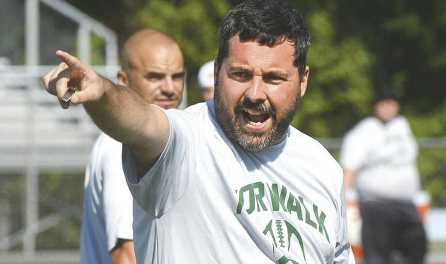 Hour photo/Alex von KleydorffNorwalk High School football coach Sean Ireland gestures to his team during Friday's first official practice of the new season at Testa Field.