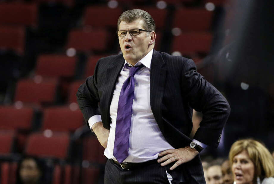 Connecticut coach Geno Auriemma follows his team during the first half of a regional semifinal against BYU in the NCAA college basketball tournament in Lincoln, Neb., Saturday, March 29, 2014. (AP Photo/Nati Harnik)