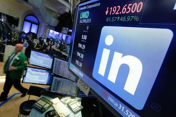 The LinkeIn logo appears on a screen at the post where it trades on the floor of the New York Stock Exchange, Monday, June 13, 2016. In a surprise move, Microsoft said Monday that it is buying professional networking service site LinkedIn for about $26.2 billion. (AP Photo/Richard Drew)