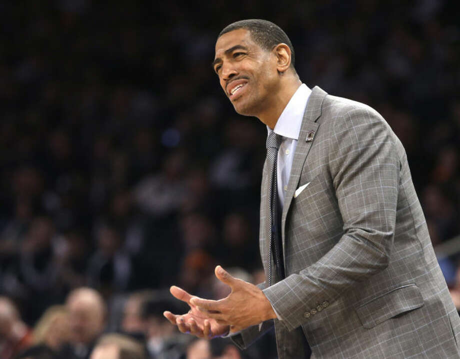 Connecticut head coach Kevin Ollie instructs his team in the first half of a regional final against Michigan State at the NCAA college basketball tournament on Sunday, March 30, 2014, in New York. (AP Photo/Frank Franklin II)