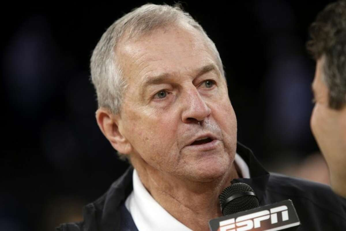 Former Connecticut basketball coach Jim Calhoun responds to questions during a news interview after a regional final between Connecticut and Michigan State in the NCAA college basketball tournament on Sunday, March 30, 2014, in New York. Connecticut won the game 60-54. (AP Photo/Frank Franklin II)