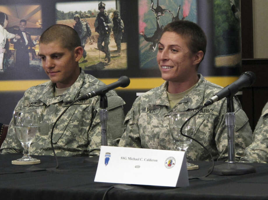 U.S. Army Army 1st Lt. Shaye Haver, right, speaks with reporters, Thursday, Aug. 20, 2015, at Fort Benning, Ga., where she was scheduled to graduate Friday from the Army's elite Ranger School. Haver and Army Capt. Kristen Griest are the first two women to complete the notoriously grueling Ranger course, which the Army opened to women this spring as it studies whether to open more combat jobs to female soldiers. (AP Photo/Russ Bynum)
