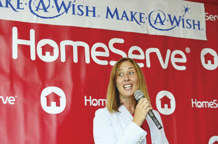 Hour photo / Erik Trautmann Make-A-Wish foundation and their Development Officer, Maria Arnold, speaks during a check passing ceremony where a $23,000 donation to the foundation was made by the Norwalk-based company HomeServe USA Thursday morning at HomeServe USA headquarters. The gift to the foundation was a result of HomeServe employees raising nearly $11,500 through several charitable initiatives, which was matched by the company.