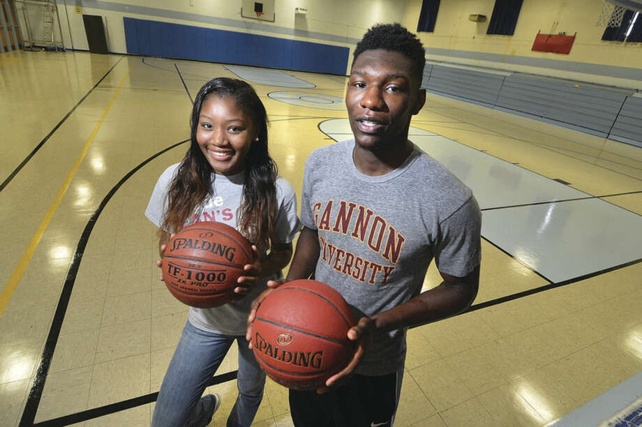 Hour Photo/Alex von KleydorffSiblings Denisha Gardener, left, and her brother Ian, stand in the Kolbe Cathedral gym in Bridgeport on Friday, just days before leaving for their respective college basketball careers.
