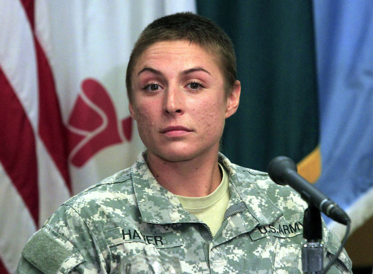 U.S. Army Army 1st Lt. Shaye Haver speaks with reporters, Thursday, Aug. 20, 2015, at Fort Benning, Ga., where she is scheduled to graduate Friday from the Army's elite Ranger School. Haver and Army Capt. Kristen Griest are the first two women to complete the notoriously grueling Ranger course, which the Army opened to women this spring as it studies whether to open more combat jobs to female soldiers. (Mike Haskey /Ledger-Enquirer via AP) MANDATORY CREDIT