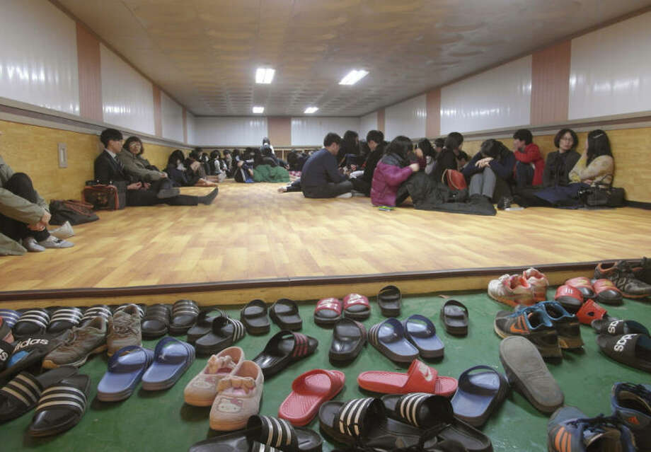 Residents and students of Yeonpyeong Island evacuate to a shelter on the island, South Korea, near the West Sea border with North Korea, Monday, March 31, 2014. North and South Korea fired artillery shells into each other's waters Monday, a flare-up of animosity between the rivals that forced residents of five front-line South Korean islands to evacuate to shelters, South Korean officials said. (AP Photo) KOREA OUT