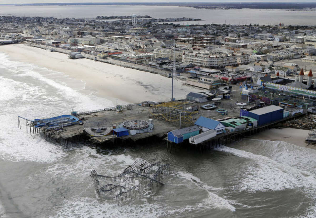 AP Photo/Mike Groll, File This Oct. 31, 2012 file photo, shows an aerial view of the damage to an amusement park left in the wake of Superstorm Sandy, in Seaside Heights, N.J.