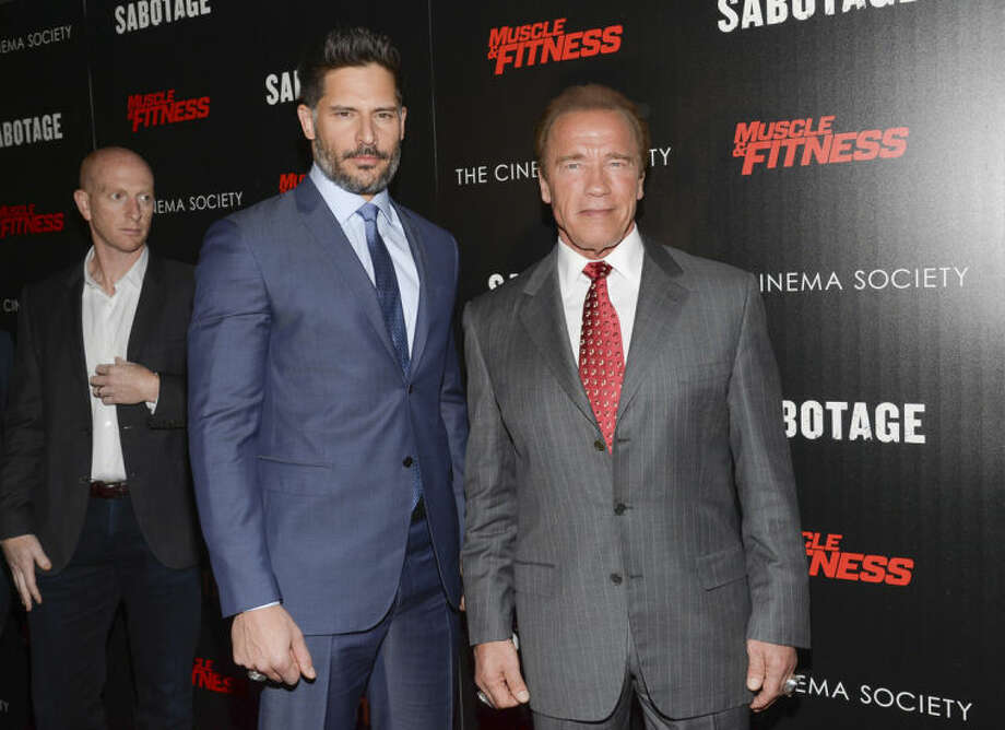 """In this Tuesday, March 25, 2014 file photo, actors Joe Manganiello, left, and Arnold Schwarzenegger attend a special screening of Open Road Films' """"Sabotage,"""" hosted by The Cinema Society with Muscle & Fitness at AMC Lincoln Square, in New York. The film releases Friday, March 28, 2014. (Photo by Evan Agostini/Invision/AP)"""