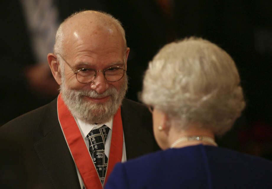 """FILE - This is a Nov. 26, 2008 file photo of Dr Oliver Sacks, receiving his Commander of the Order of the British Empire (CBE ), by Britain's Queen Elizabeth II at Buckingham Palace, London. Dr. Oliver Sacks, whose books like """"The Man Who Mistook His Wife For a Hat"""" probed distant ranges of human experience by compassionately portraying people with severe and sometimes bizarre neurological conditions, has died. He was 82 .Sacks died Sunday at his home in New York City, his assistant, Kate Edgar, said. (Lewis Whyld/PA via AP) UNITED KINGDOM OUT NO SALES NO ARCHIVE"""