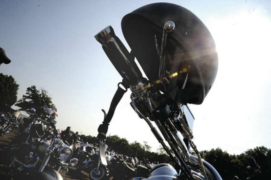 Hour photo/Matthew VinciA biker's helmet rests atop a handlebar during the 15th Annual CT United Ride on Sunday.