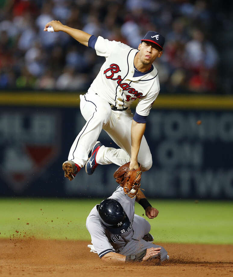 New York Yankees' Jacoby Ellsbury (22) is tagged out by Atlanta Braves shortstop Andrelton Simmons (19) as he tries to steal second base in the fifth inning of a baseball game Saturday, Aug. 29, 2015, in Atlanta. (AP Photo/John Bazemore)