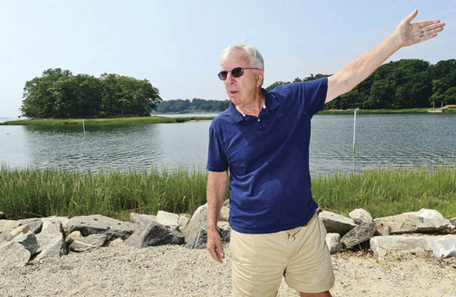 Hour photo / Erik TrautmanJohn Moeling, President of Norwalk Land Trust, describes how Terrapin turtles use Village Creek Beach as a spawning ground and live and hunt on nearby Hoyt Island and upstream in Village Creek.
