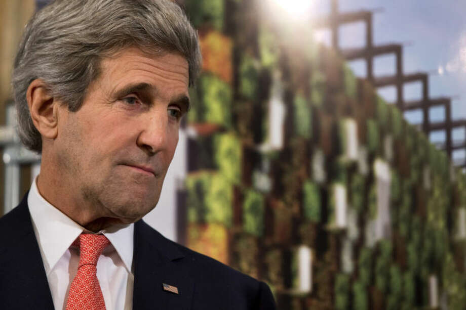 In this March 27, 2014, photo, Secretary of State John Kerry attends a reception for U.S. companies based in Italy that are donors and potential donors for a USA Pavillion at the Milan Expo 2015, in Rome. Halfway home from Saudi Arabia, Kerry has abruptly changed course and will stay in Europe for talks on Ukraine. Flying from Riyadh to Shannon, Ireland, for a refueling stop on Saturday, Kerry decided to turn his plane around and will now travel to Paris for a meeting with Russian Foreign Minister Sergey Lavrov, likely on Monday. (AP Photo/Jacquelyn Martin, Pool)